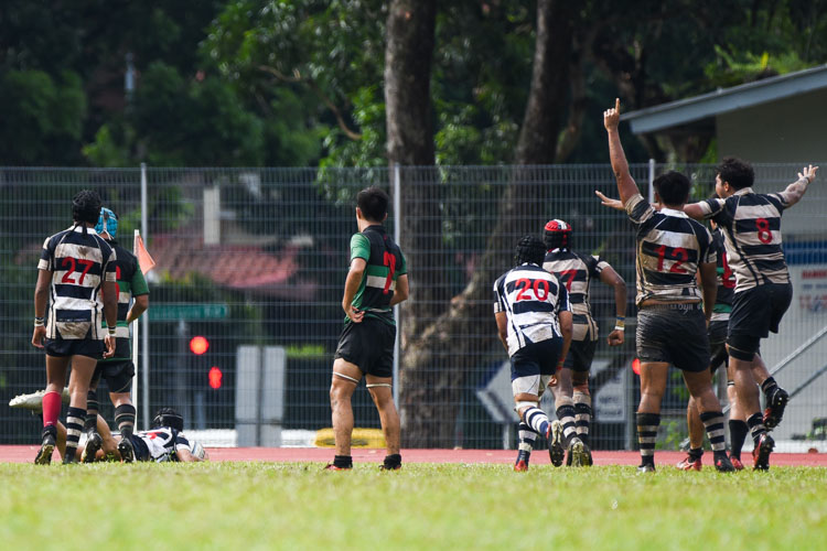 Saints celebrate a late try by Matthew Ng (SAJC #15) that cut their deficit to just two points. (Photo 1 © Iman Hashim/Red Sports)