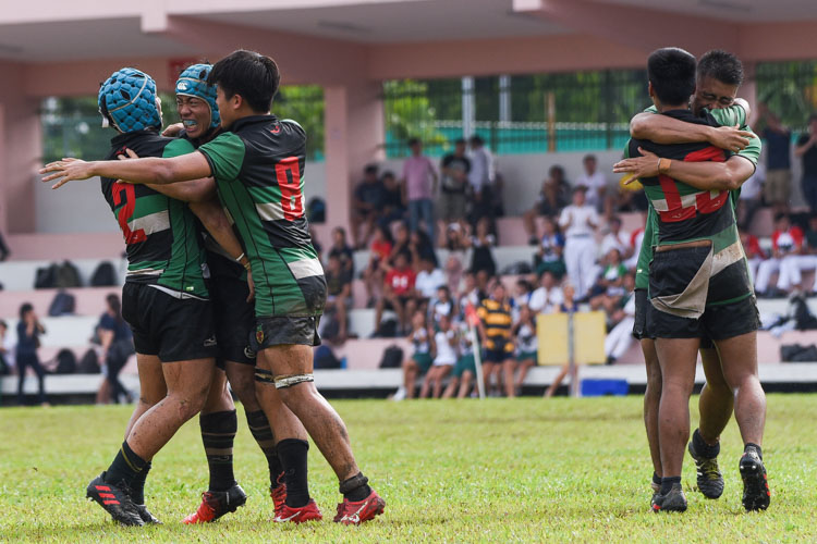 RI players celebrate after holding off a late Saints challenge to move on to the A Division rugby final. (Photo 1 © Iman Hashim/Red Sports)
