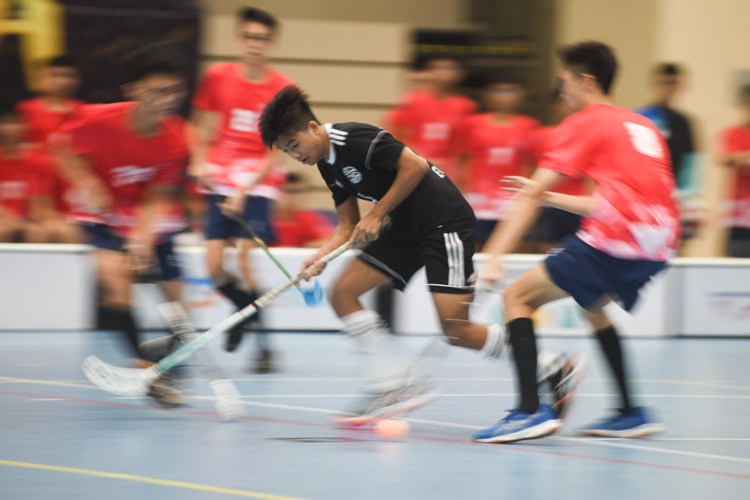 EJC's Edgar (#14) dribbling past a tight River Valley defence during the match. In a clash between two first-time semi-finalists of the National A Division Floorball Championship, dark horses Eunoia Junior College (EJC) came out tops with a convincing 6-1 victory over River Valley High School (RV). (Photo 1 © Stefanus Ian/Red Sports)