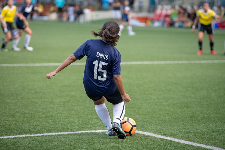 Vanessa Au (SA #15) takes a goalkick for keeper Shareen Kaur (#1).