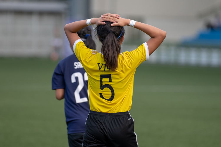 Leong Hui Ling (VJ #5) puts her hands on her head in frustration after being denied a goal by the Saints keeper.