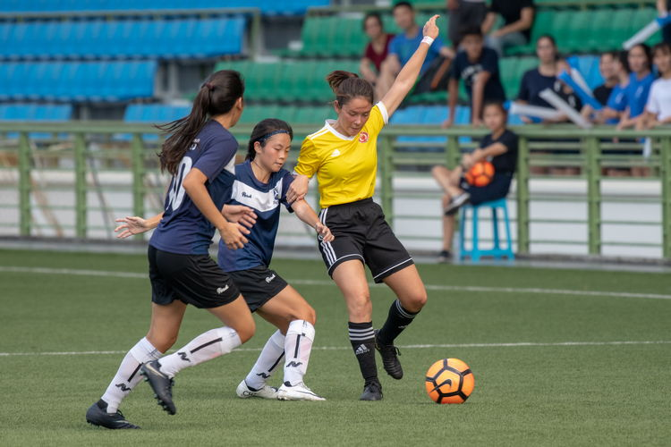 Sophia Rose Meyers (VJ #4) attempting to outmaneuver SAJC players (l to r) Sarah Lum (#10) and Clae Kho (#9).