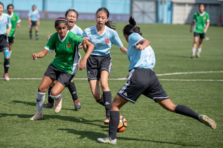 Claudia Chia (HCI #5) clears a dangerous ball.