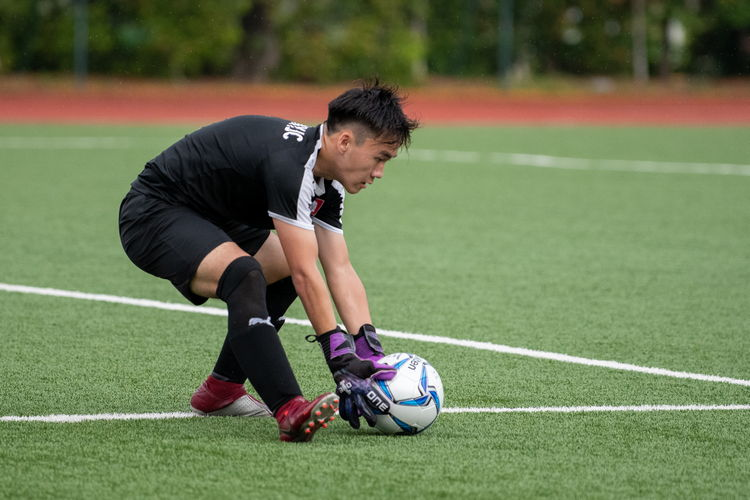 NYJC keeper Shane Lau (#1) catches an incoming ball.