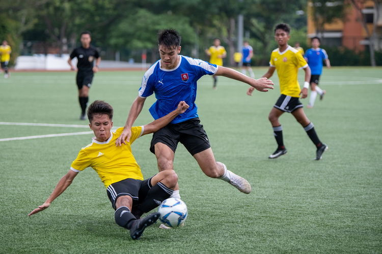 Despite the lightning alert disrupting the game roughly halfway into the second half, VJC and NYJC managed to finish their match after a short delay. In this picture, Artemus See (VJC #19) slides to tackle Vasileios Chua (NYJC #9).