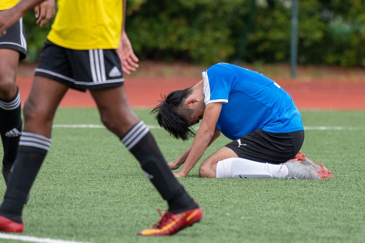 Nanyang player Neo Wei Yang (#17) overwhelmed with frustration after narrowly missing a shot on the Victorian goal.