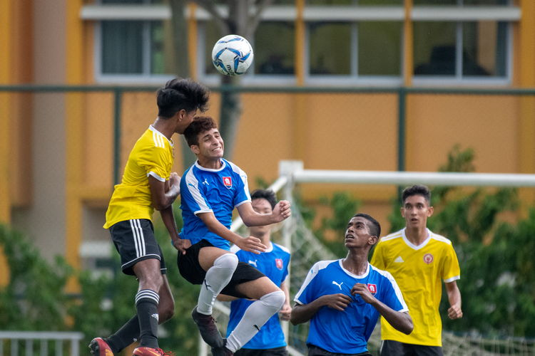 Philip Koshy (VJC #8) and Shaked Shalev (NYJC #10) fight for the header.