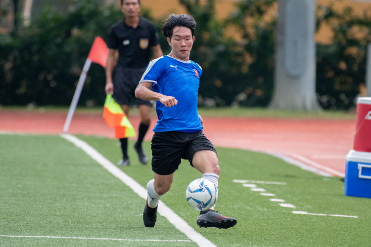 Gareth Yeo (NYJC #18) tries to stop a friendly pass from going out.