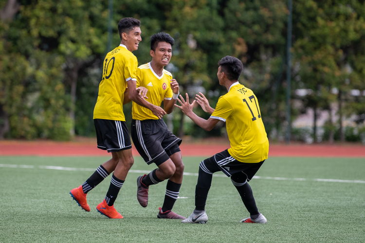 Umar B Sharin (#10) and Sirhan Muzaffar (#17) celebrate with Haikel B Zaini (#11) after one of his two goals.
