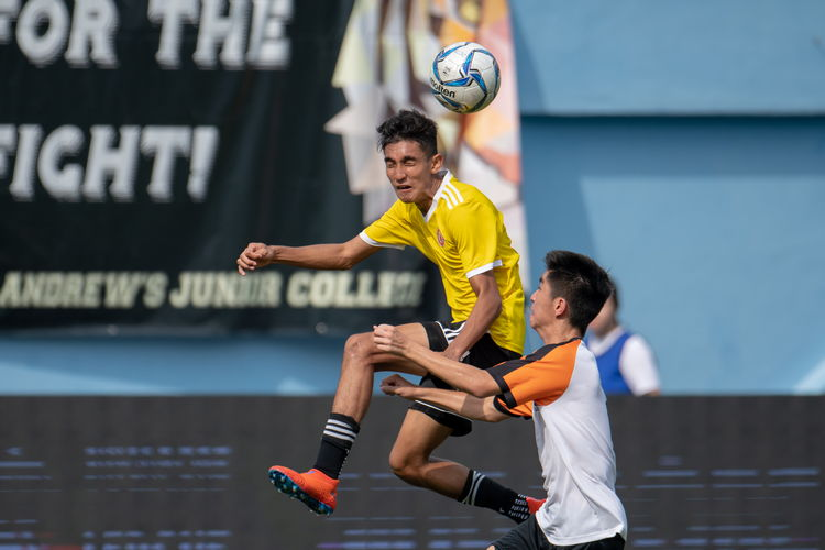 Umar B Sharin (VJC #10) leaps to header a ball.