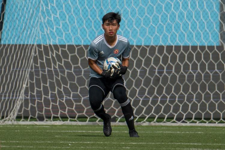 VJC keeper Wong Yi Hong (#1) catches a ball.