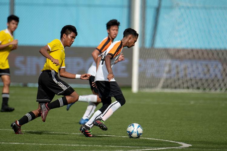 Naeemur Rahman (SAJC #14) controls the ball under pressure.