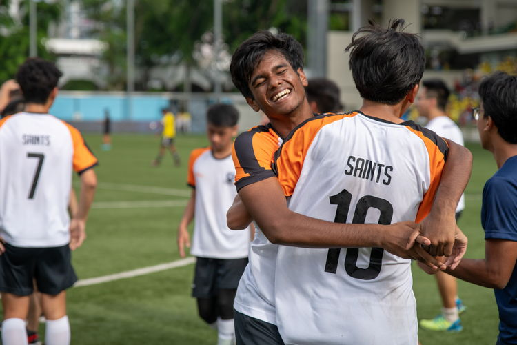 Ravi Gowtham Rakul (#12) and Naven Joshua Timothy Koh (#10) embrace after the match.