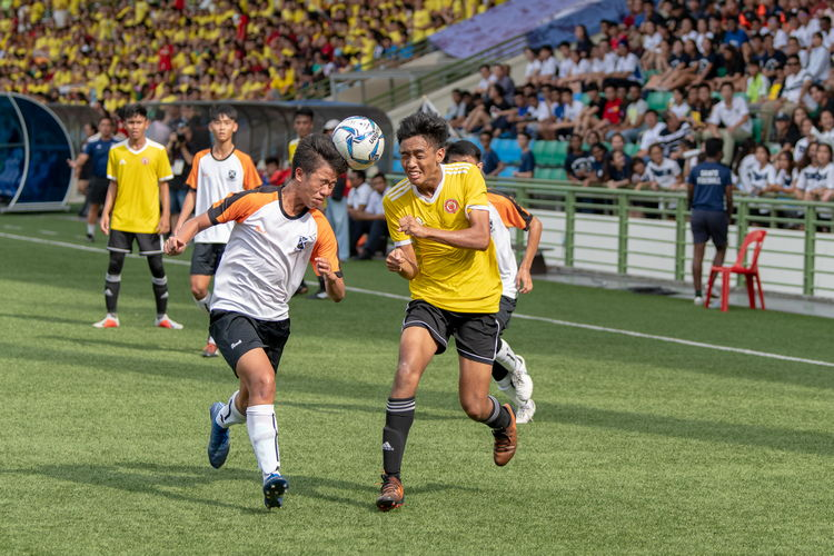 Naden Joshua Timothy Koh (SAJC #10) headers the ball away from Amir Hafiq (VJC #9).