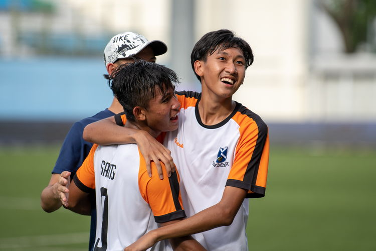 "So-called ""man of the match"" Ahmad Yusuf (#9) and Nadan Joshua Timothy Koh (#10) share a moment of joy together after winning the championship."