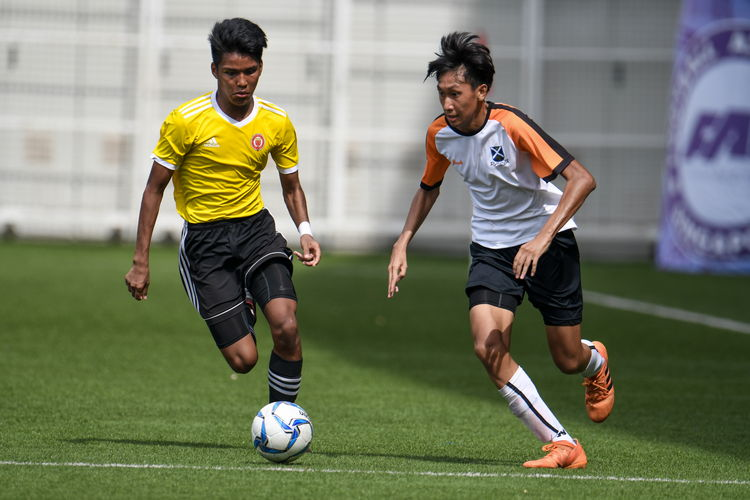 Haikel B Zaini (VJC #11) dribbles the ball up the left wing. Naden Joshua Timothy Koh (SAJC #10) looks to tackle.