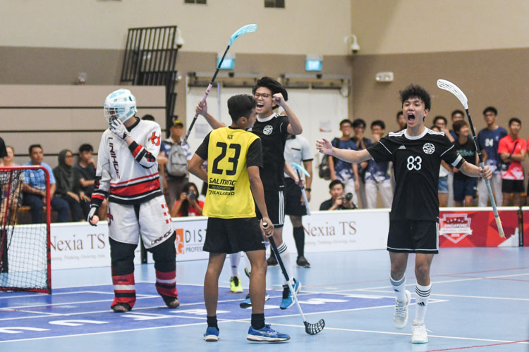 EJC celebrate at the end of the match after holding off a late VJC challenge to win 4-3 and secure the title. (Photo 1 © Iman Hashim/Red Sports)