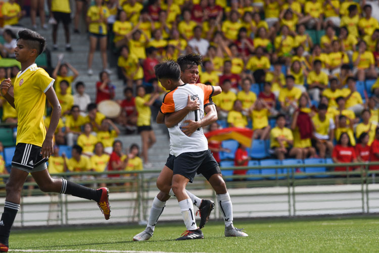 Ahmad Yusuf (SAJC #9) embraces teammate Zachariah Lim (SAJC #11) after scoring his team's third goal. (Photo 1 © Iman Hashim/Red Sports)