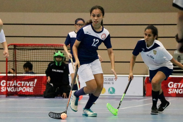 Farah Bte Abdul Rahim (#12) of TMJC in action as she attempts to shoot
