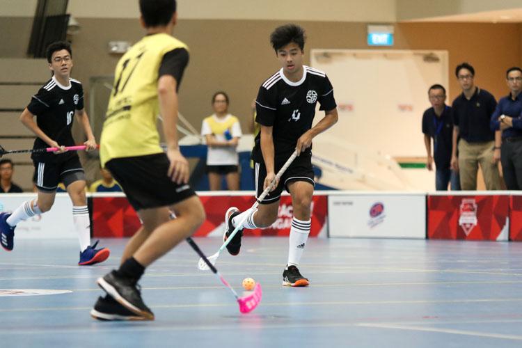 Edgar Kwa Jing Rui (EJC #14) dribbles the ball down in attack. (Photo 3 © Clara Lau/REDintern)