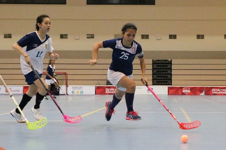 Sharifah Alhadi (#25) of TMJC in action as she brings the ball across the court.