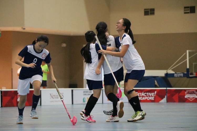 CJC Players celebrate after they score a point against TMJC.
