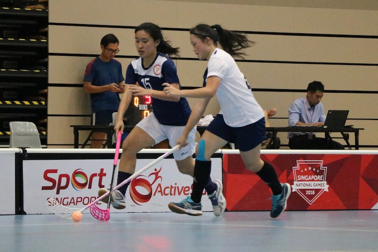 Yap Xin Yi (#15) in action as she attempts to steal the ball from her opponent.