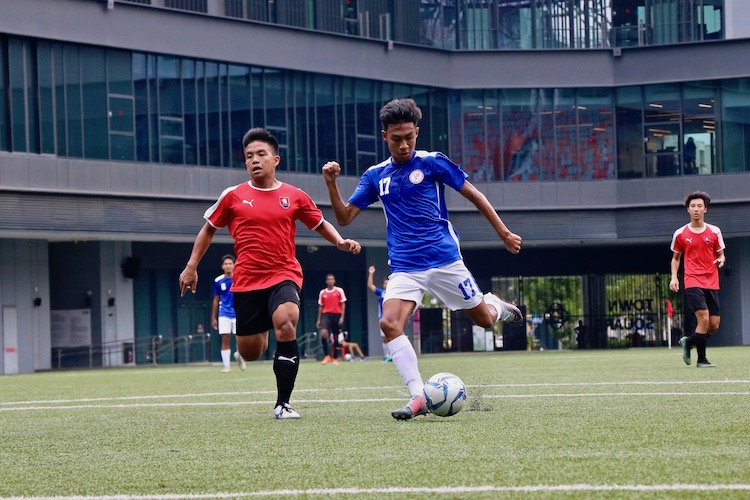 Nauman Adiel (#17) of TMJC in action as he takes a shot towards the goal