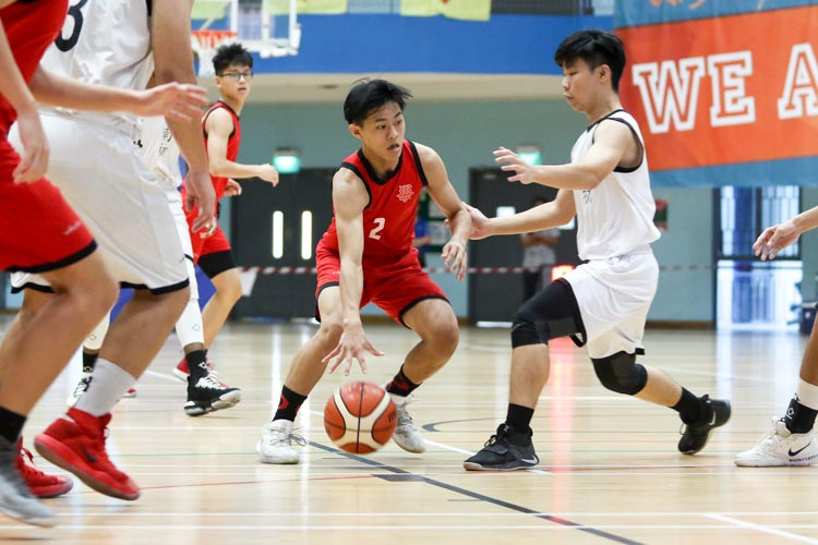 Lim Jing Jie (HCI #2) tries to dribble his way past NYJC's defence. (Photo 2 © Clara Lau/Red Sports)