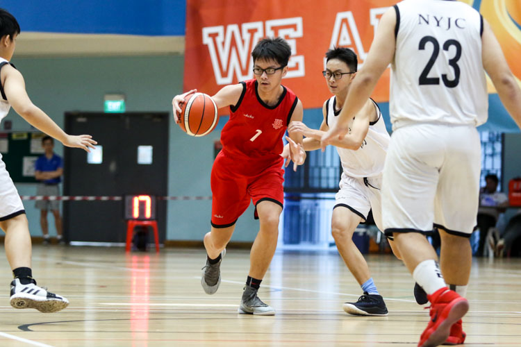 Chan Yu Cher (HCI #7) attempts to keep possession under the close watch of NYJC defenders. (Photo 4 © Clara Lau/Red Sports)