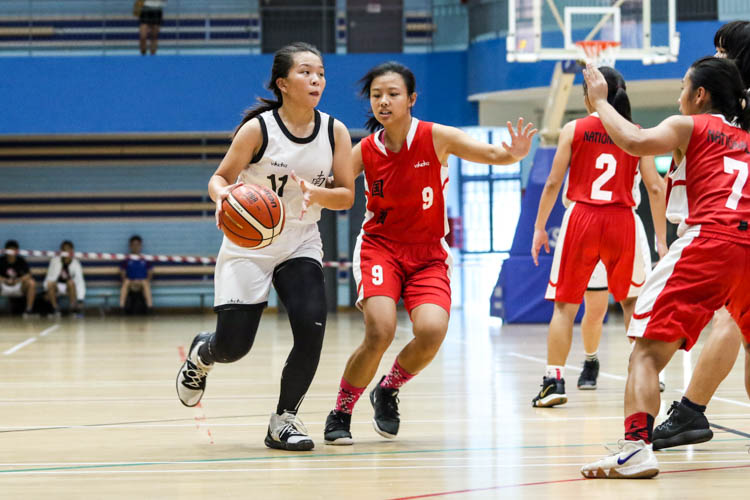Yeo Ding Xin (NYJC #11) tries to shield the ball from Joanna Wei (NJC #9) as she dribbles the ball down the court. (Photo 2 © Clara Lau/Red Sports)