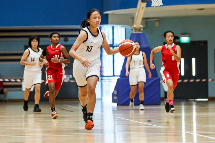 Jermaine Lim (NYJC #10) dribbles her way down the court. (Photo 6 © Clara Lau/Red Sports)