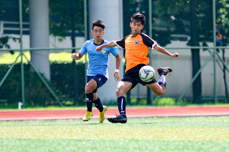 Lim Sheng Yao Zachariah (SAJC #11) volleys the ball towards goal. (Photo 6 © Clara Lau/REDintern)