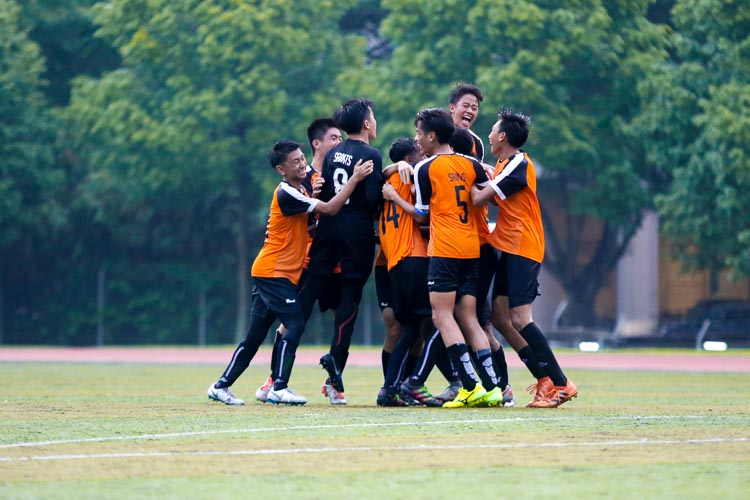 SAJC players celebrating after Darren Leong (SAJC #3) converts his penalty to send SAJC through to the finals. (Photo 1 © Clara Lau/REDintern)