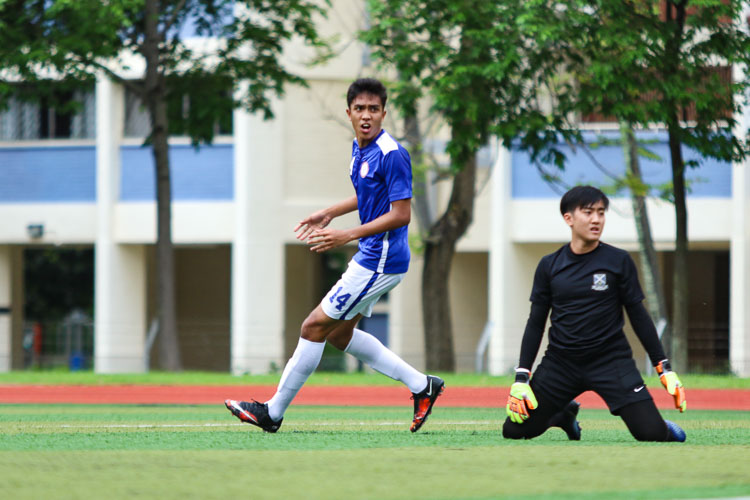 Luqman Hakim (TMJC #14) watches as his ball trickles into the goal, giving TMJC the early lead. (Photo 2 © Clara Lau/REDintern)