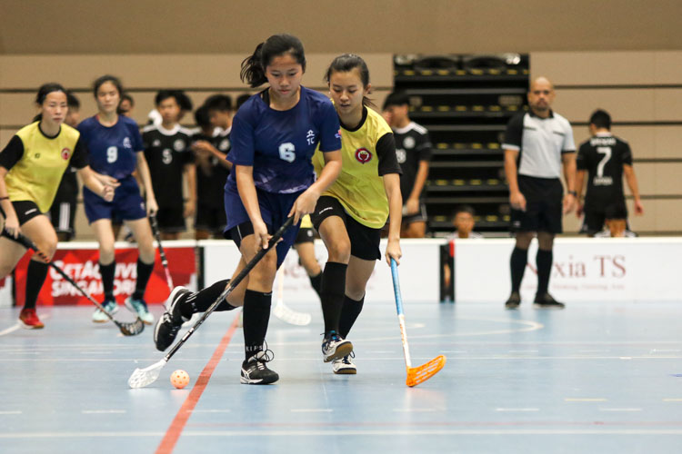 Heng Ying Ying (RV #6) dribbles the ball forward under close watch from VJC defenders. (Photo 12 © Clara Lau/REDintern)