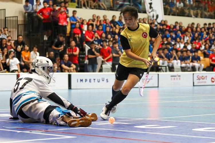 Megan Ng Ker Yii (VJC #45) takes the ball around the keeper to convert her penalty shot. (Photo 19 © Clara Lau/REDintern)