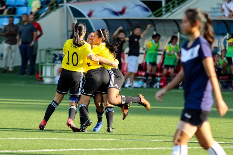 VJC players celebrating the opening goal of the game scored by Nur Darwisyah (VJC #12). (Photo 4 © Clara Lau/REDintern)
