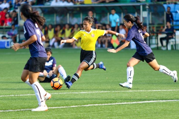 Nur Darwisyah (VJC #12) attempts a shot at goal. (Photo 5 © Clara Lau/REDintern)