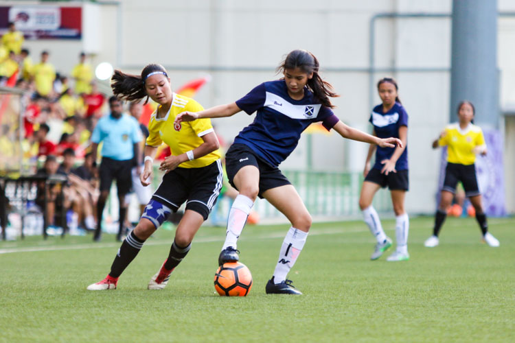 Captain Sarah Lum (SAJC #10) shields the ball from Joie Teo (VJC #10). (Photo 8 © Clara Lau/REDintern)