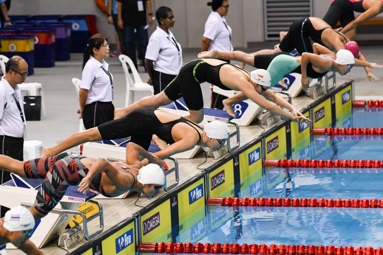 Participants of the Women's 400m Freestyle event jumping in at the start of the race at the 15th SNSC 2019 competitions.