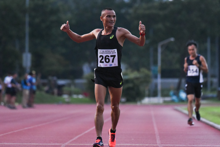 Nimesh Gurung punches his fists after finishing the Men's 5000m in second place. (Photo 1 © Iman Hashim/Red Sports)