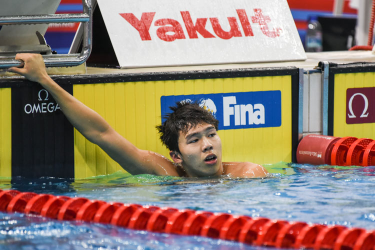 Jonathan Tan, 17, catches his breath after winning the Men's 50m Freestyle A-final with a time of 22.55 seconds. (Photo 1 © Iman Hashim/Red Sports)