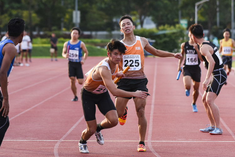 Sing Hui (#225) of NUS handing over to teammate Russell Kam between the first and second legs of the Men's 4x400m Relay. NUS emerged champions in a time of 3:27.69. (Photo 1 © Iman Hashim/Red Sports)