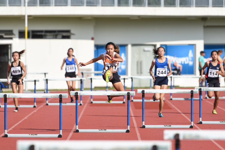 Celeste Goh of NUS clinched gold in the Women's 400m Hurdles with a time of 1:08.38. (Photo 1 © Iman Hashim/Red Sports)
