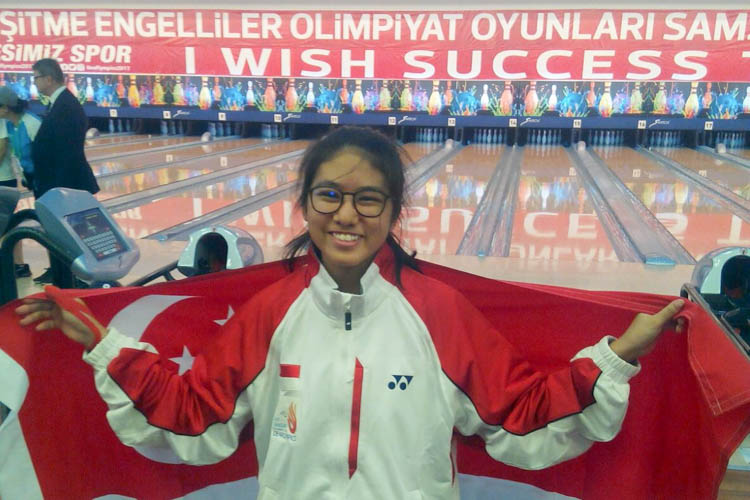 Adelia could not join her sisters in sailing due to her cochlear implant and picked up bowling instead. Little did she know that she would make history for Singapore in her bowling journey. Here is Adelia all smiles after winning gold medal in Master's event at Deaflympics 2017. (Photo courtesy of Adelia Naomi Yokoyama)
