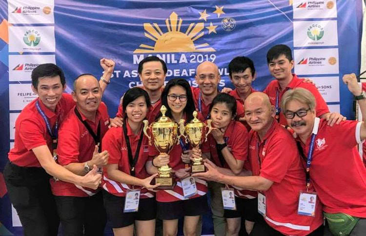 Group photo of Team Singapore deaf bowlers. Adelia bagged two gold and three silver medals at ASEAN Deaf Bowling Championship. (Photo courtesy of Deaf Sports Association)[/caption]