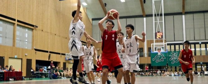 Jayson Tan (DSS #7) in action against defenders of Catholic High.
