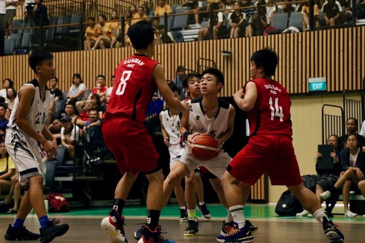 Ng Yu Jun (CHS #9) in action against Dunman High defenders.