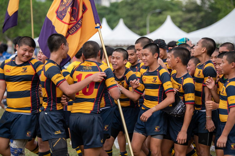 ACS(I) players celebrating with each other after their 19-7 victory over St Andrew's Secondary School in the C Division rugby Cup final. (Photo 1 © Jared Khoo/Red Sports)